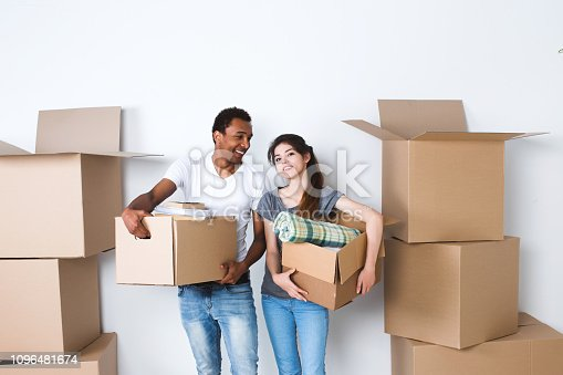 Moving to a new home. Man and woman with boxes, housewarming.