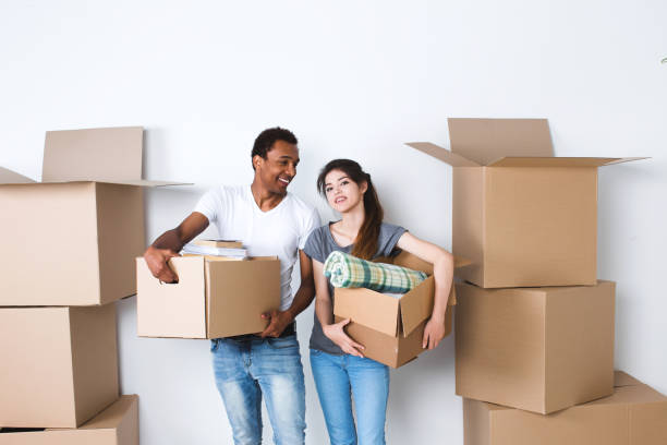 Man and woman with boxes, housewarming. stock photo