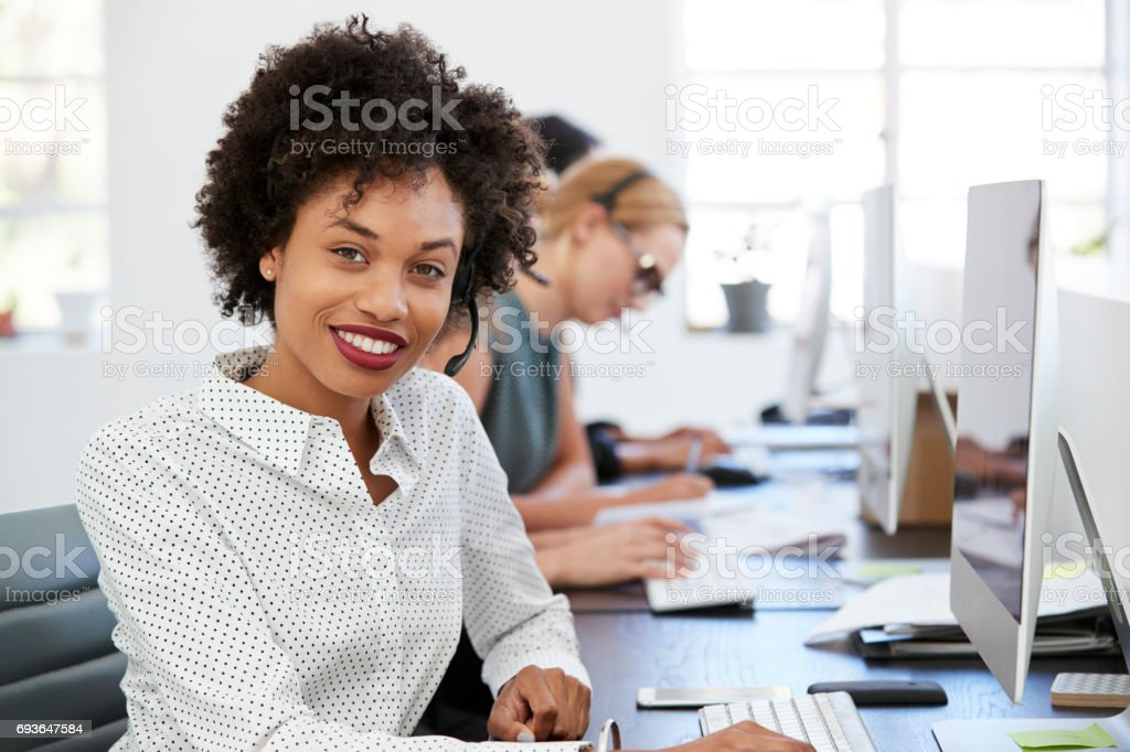 Man and woman with documents in an office, smiling, close up stock photo