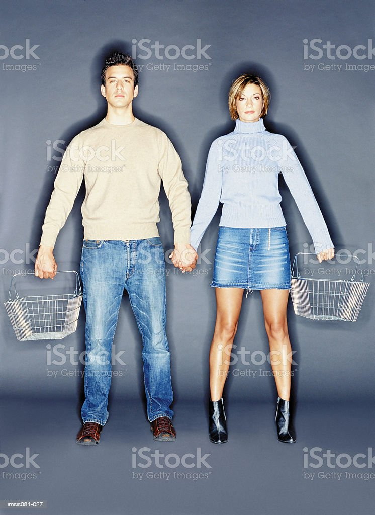 Man and woman with empty shopping basket royalty-free stock photo