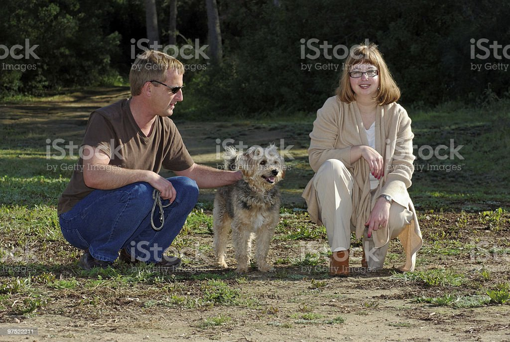 Man and Woman with Little Dog royalty-free stock photo