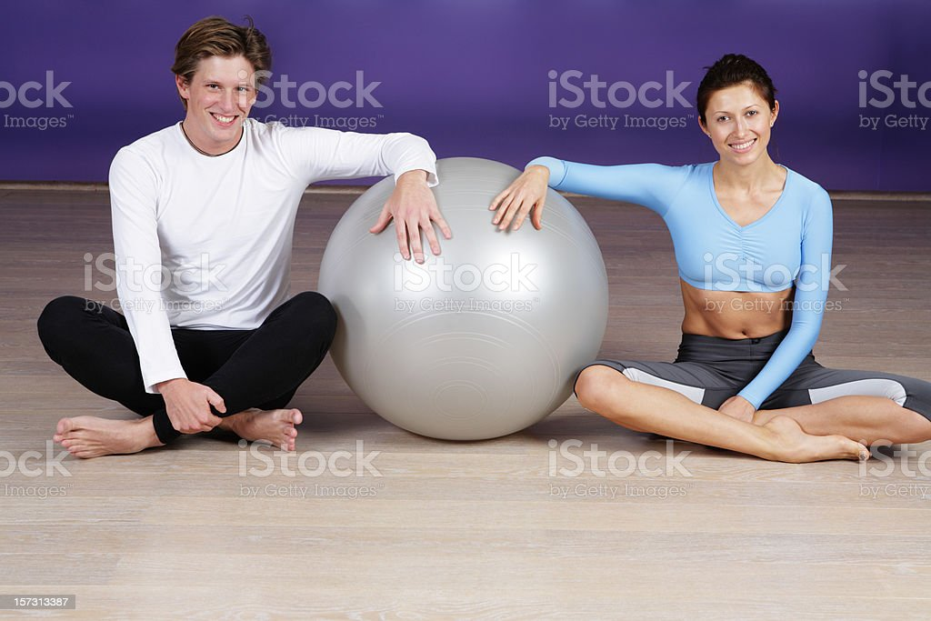 Man and woman with pilates ball royalty-free stock photo