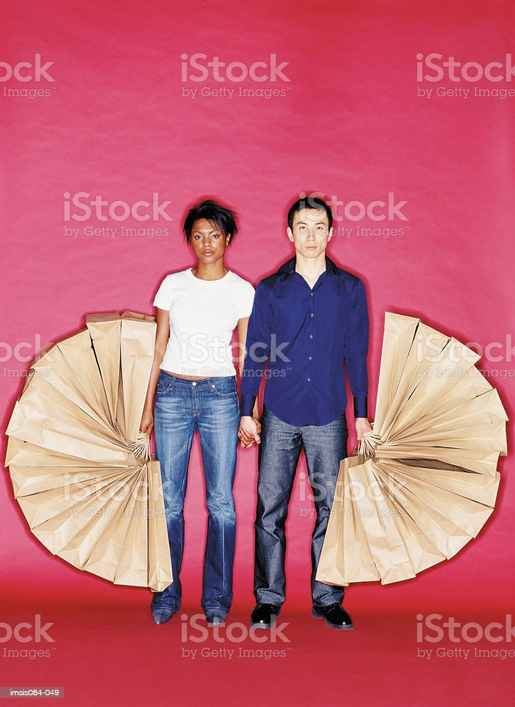 Man and woman with shopping bags 免版稅 stock photo