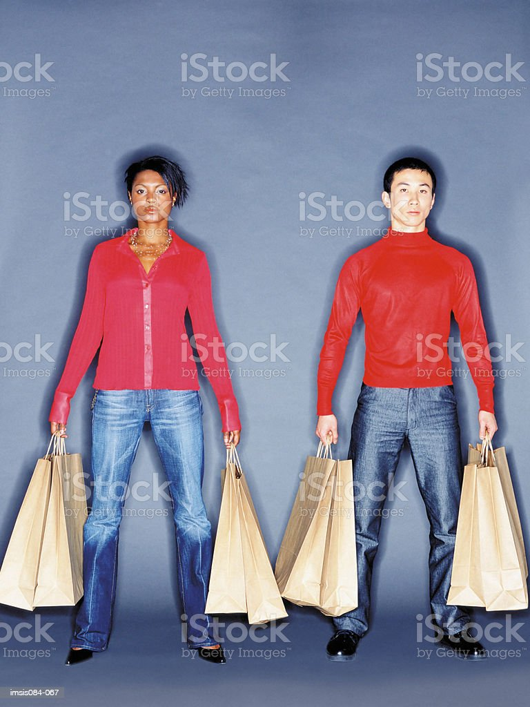 Man and woman with shopping bags royalty free stockfoto