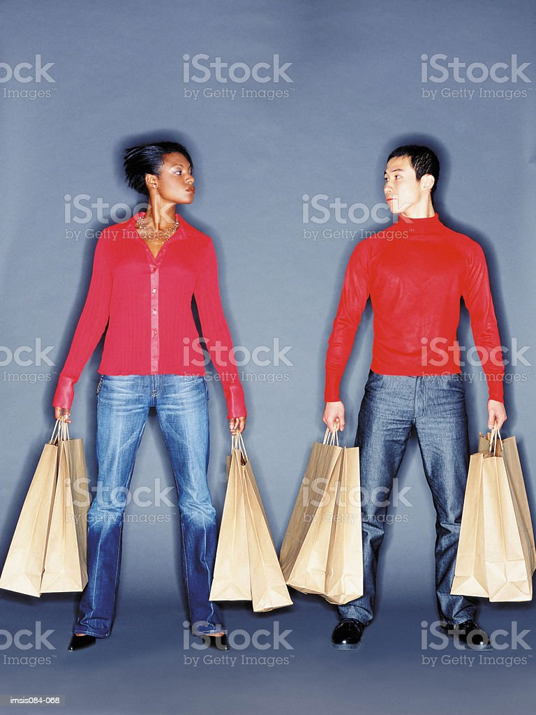 Man and woman with shopping bags royalty-free stock photo
