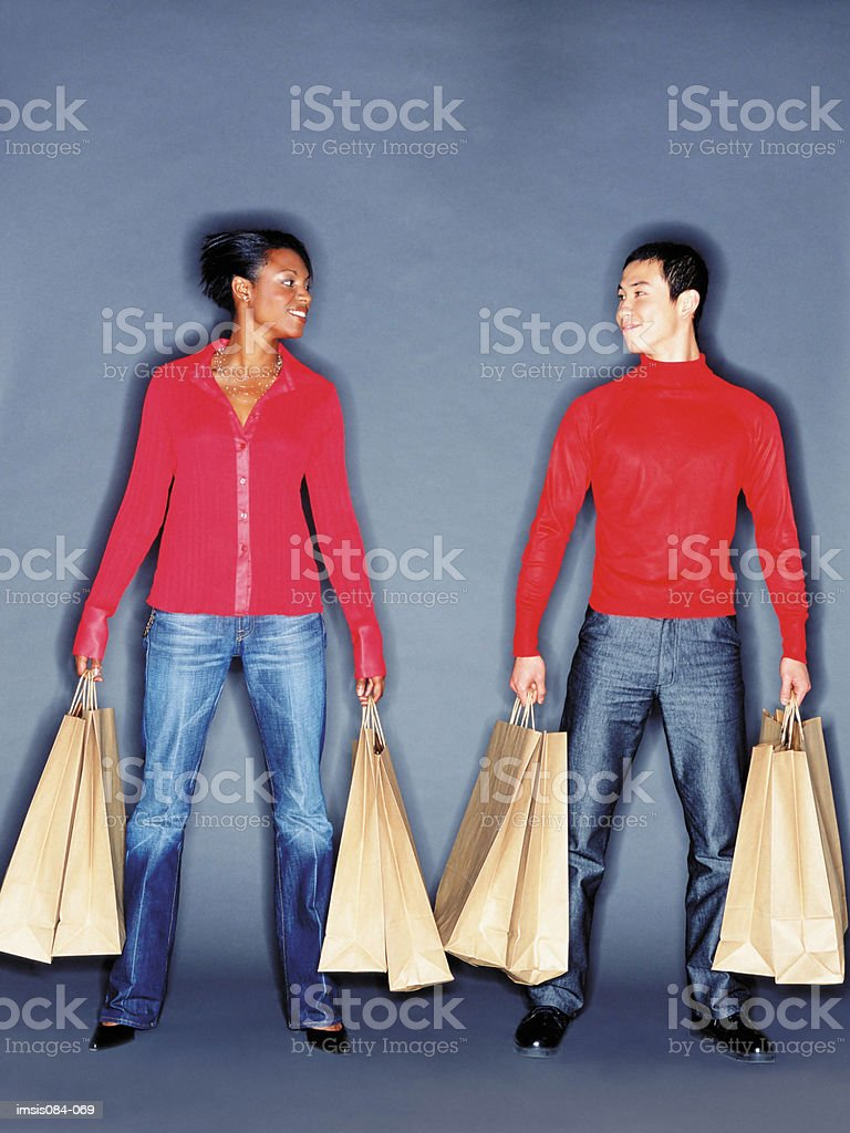 Man and woman with shopping bags royalty-free 스톡 사진