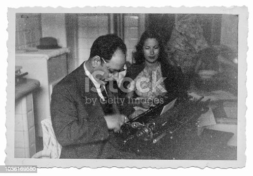 1941 man and woman with typewriter