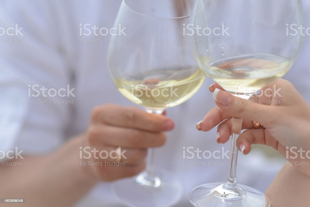 Man and woman with wine glasses stock photo