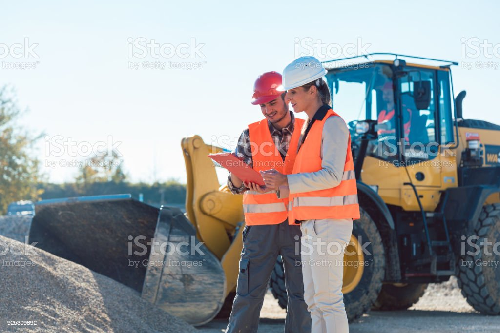 Man and woman worker on construction site stock photo