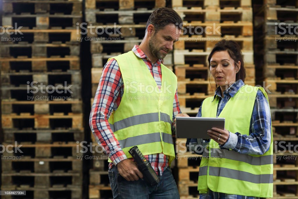 Man and woman working in a warehouse stock photo