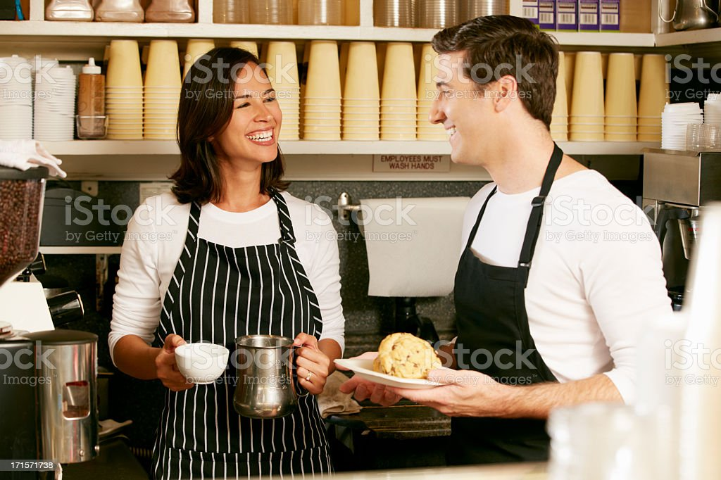 Man And Woman Working In Coffee Shop royalty-free stock photo