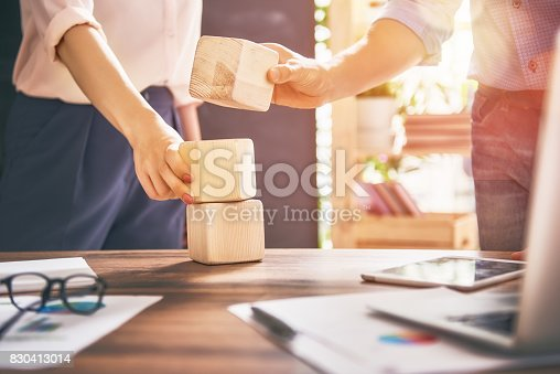 istock man and woman working in the office 830413014