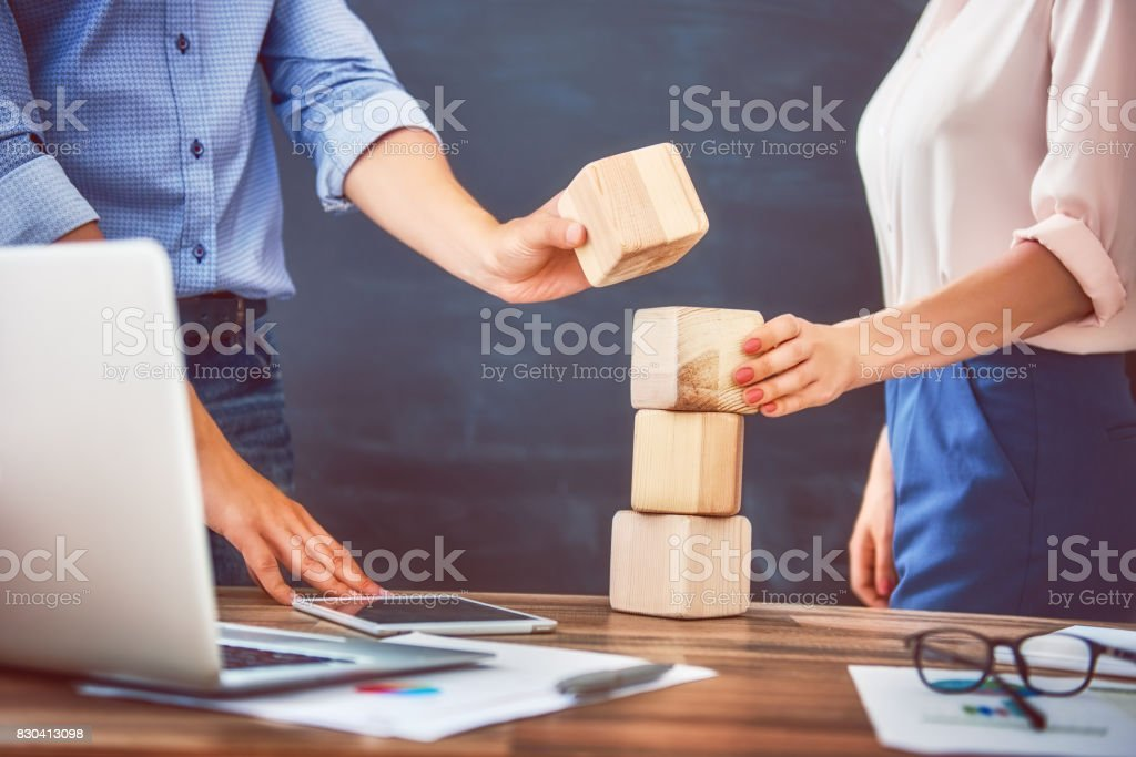 man and woman working in the office stock photo