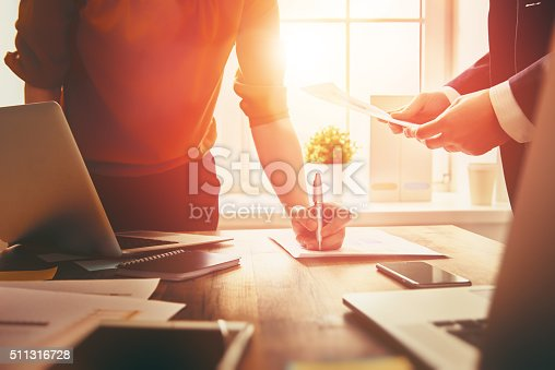istock man and woman working 511316728