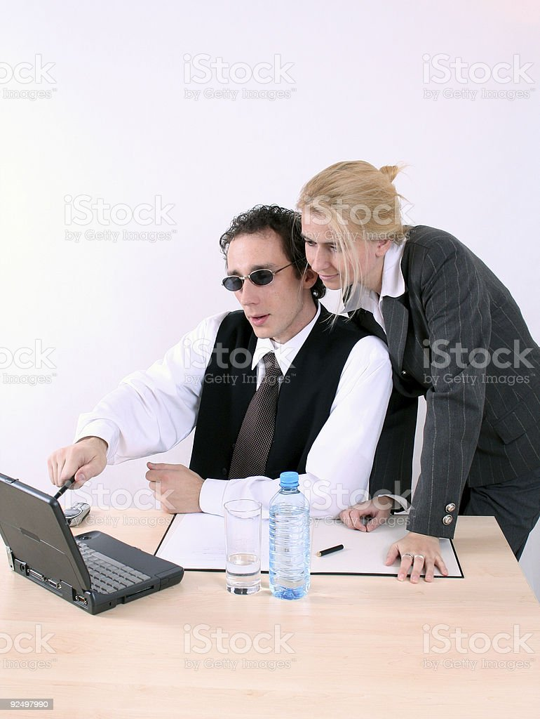 Man and woman working with computer royalty-free stock photo