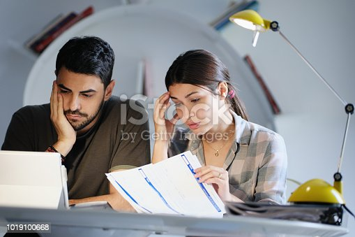 istock Man and Woman Worried For Taxes And Family Budget 1019100668