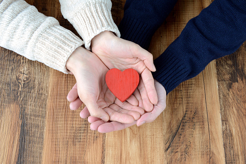 istock Man and woman's hands having heart object 1181381539