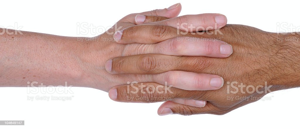 Man and Woman's Hands with Fingers Intertwined stock photo