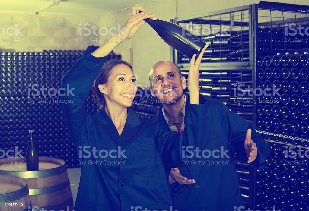 man and women coworkers looking at bubbly wine stock photo
