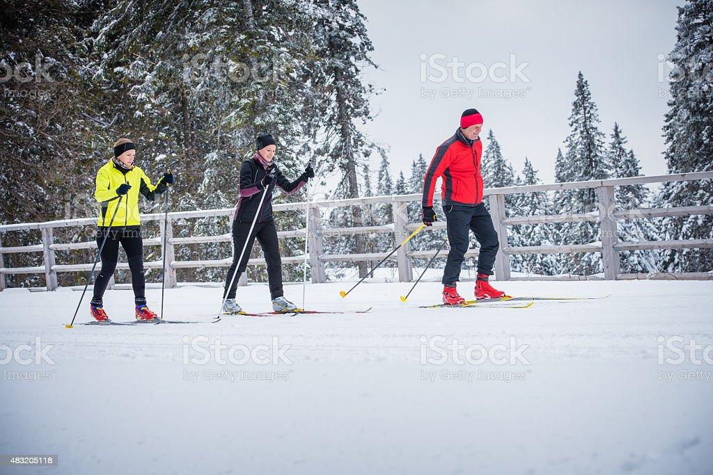 Man and women enjoying skiing stock photo