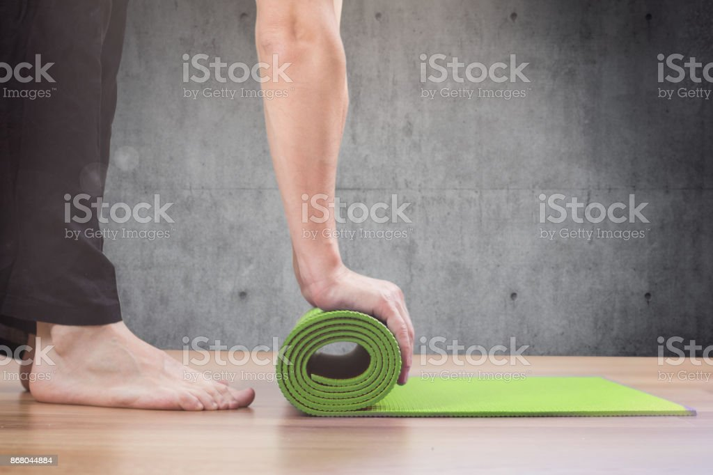 man and yoga mat stock photo