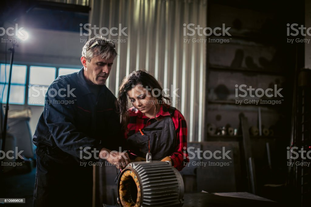 Man and women working as a mechanic in workshop