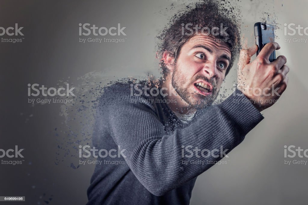 Man angry at his phone dematerializes stock photo