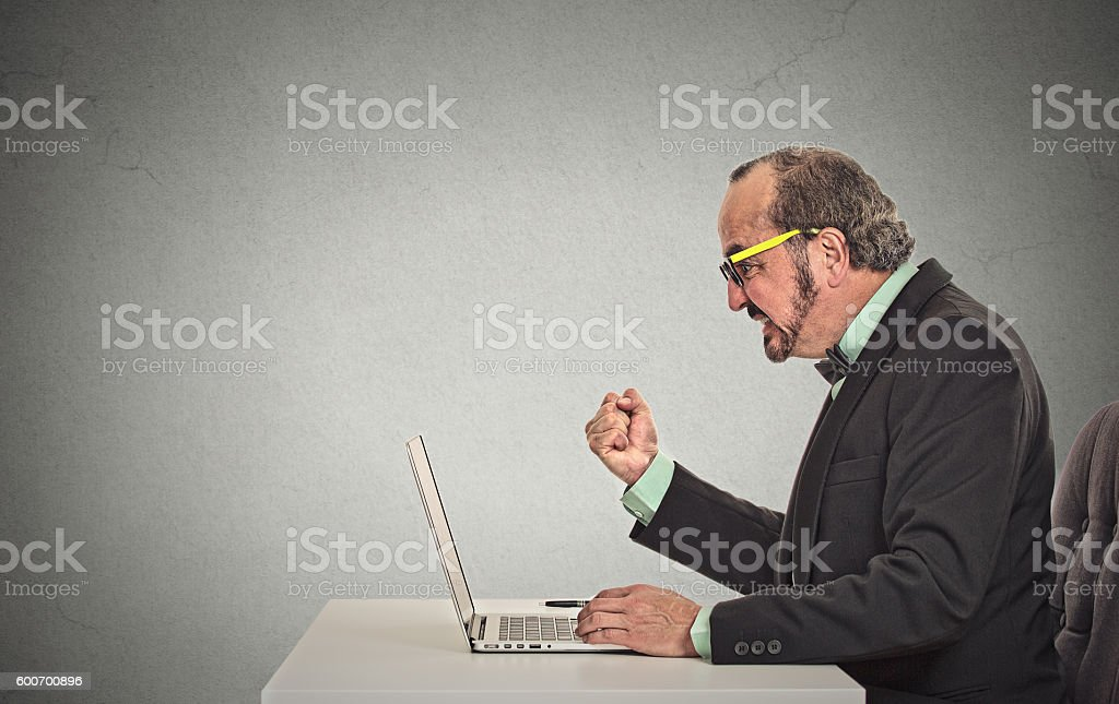 man angry frustrated at computer stock photo
