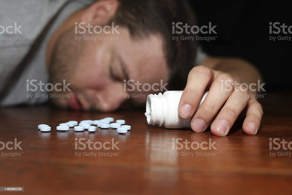 man appearing to have overdosed on pills royalty-free stock photo
