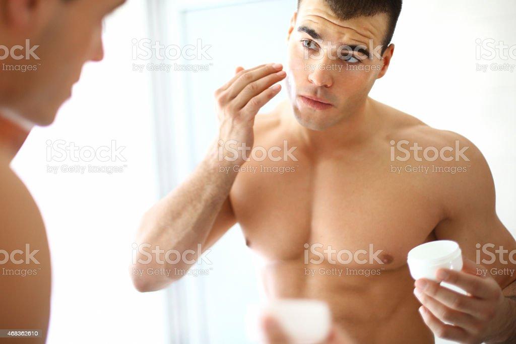 Man applying moisturizer. royalty-free stock photo