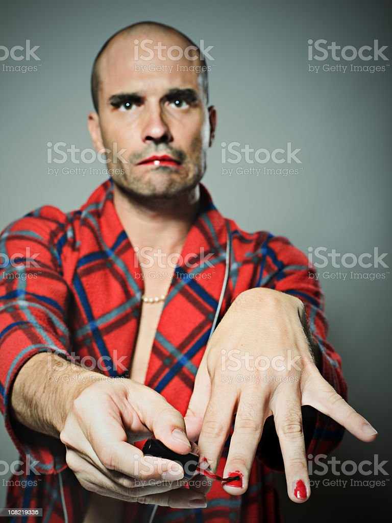 Man Applying Red Nail Polish Stock Photo & More Pictures of 20-29 ...