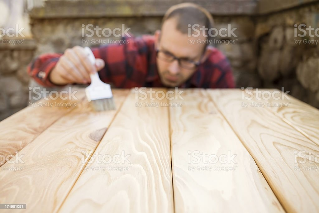 Man applying wood stain royalty-free stock photo