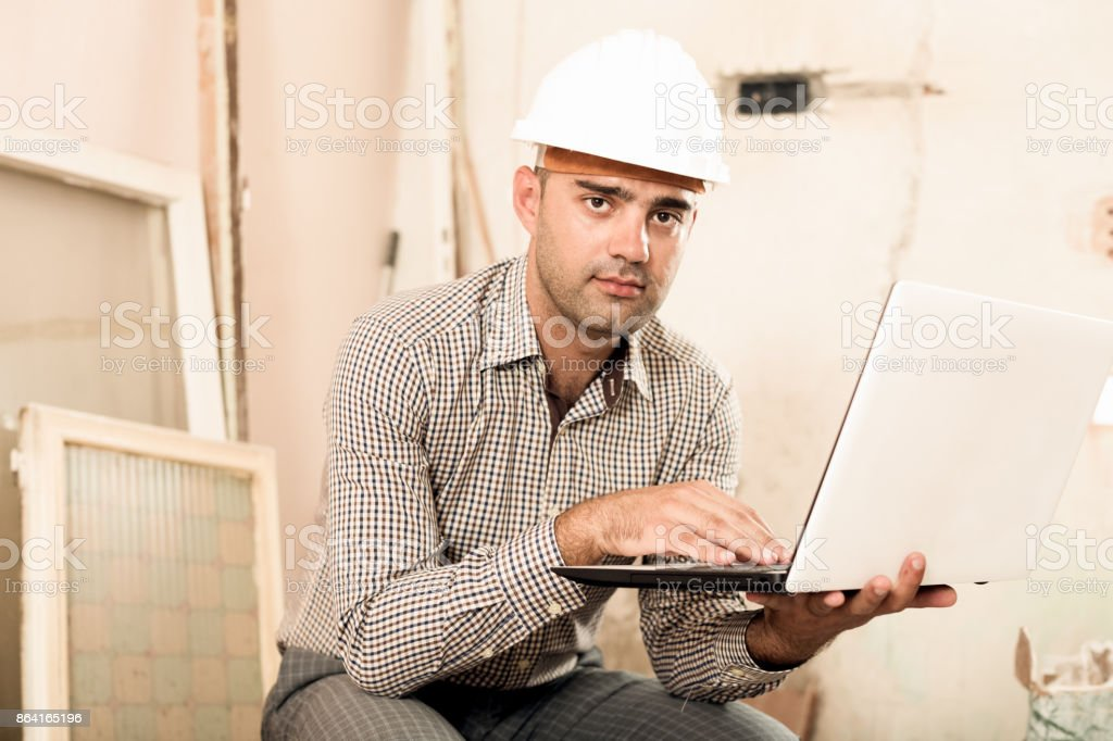 Man architect sitting near the laptop royalty-free stock photo