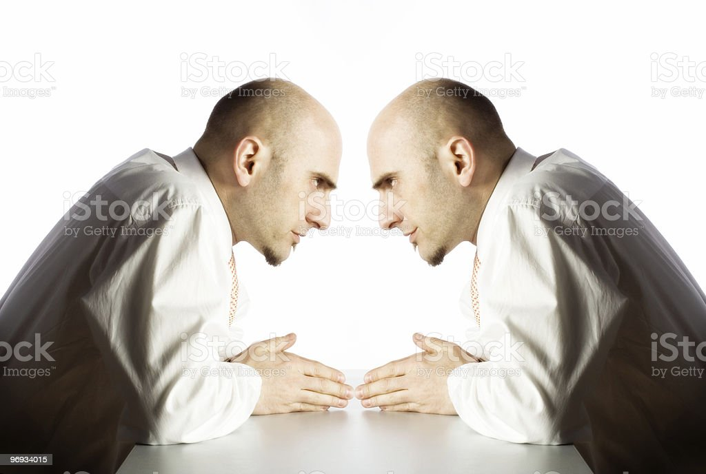Man argues with himself stock photo