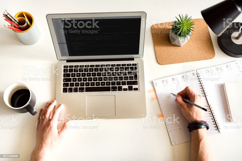 Man arms writing in pad of paper stock photo