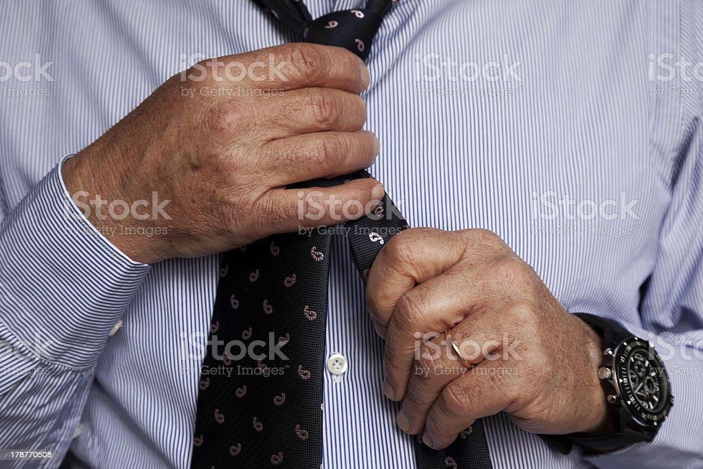 Man arranging his tie stock photo