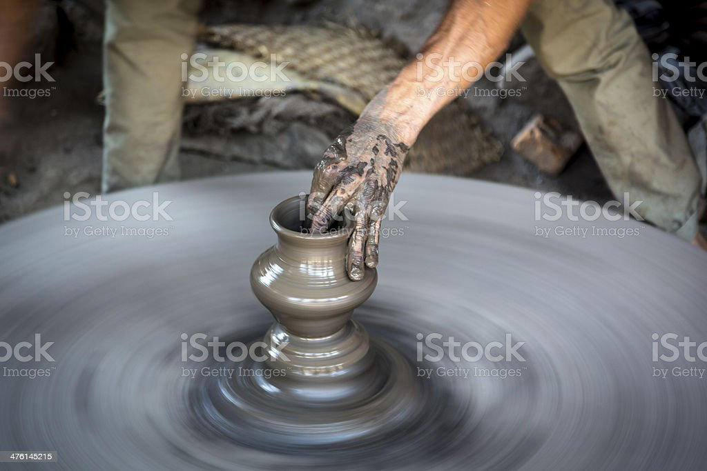 Man Artist Making Pottery on Street in Nepal royalty-free stock photo