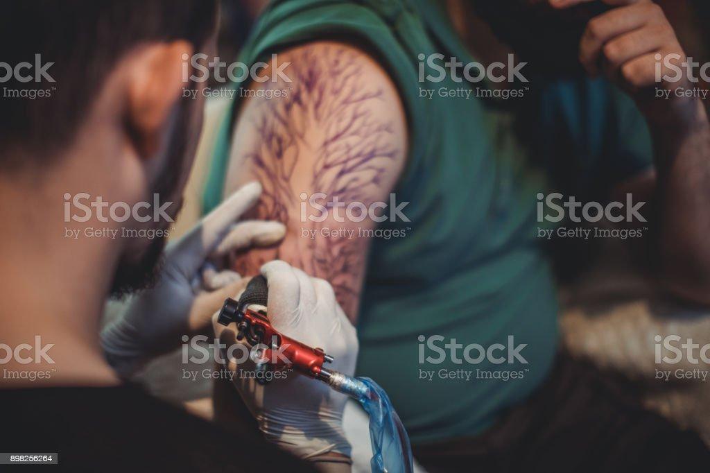 Man artist tattooing stock photo