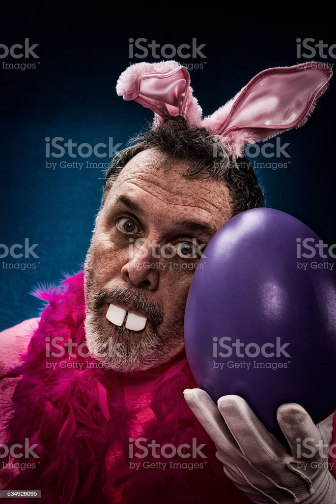Man as Deranged Easter Bunny with a large egg stock photo