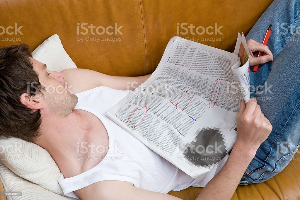 Man asleep with newspaper royalty-free stock photo