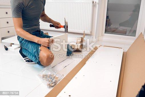 1039616354 istock photo man assembleing furniture 855179734