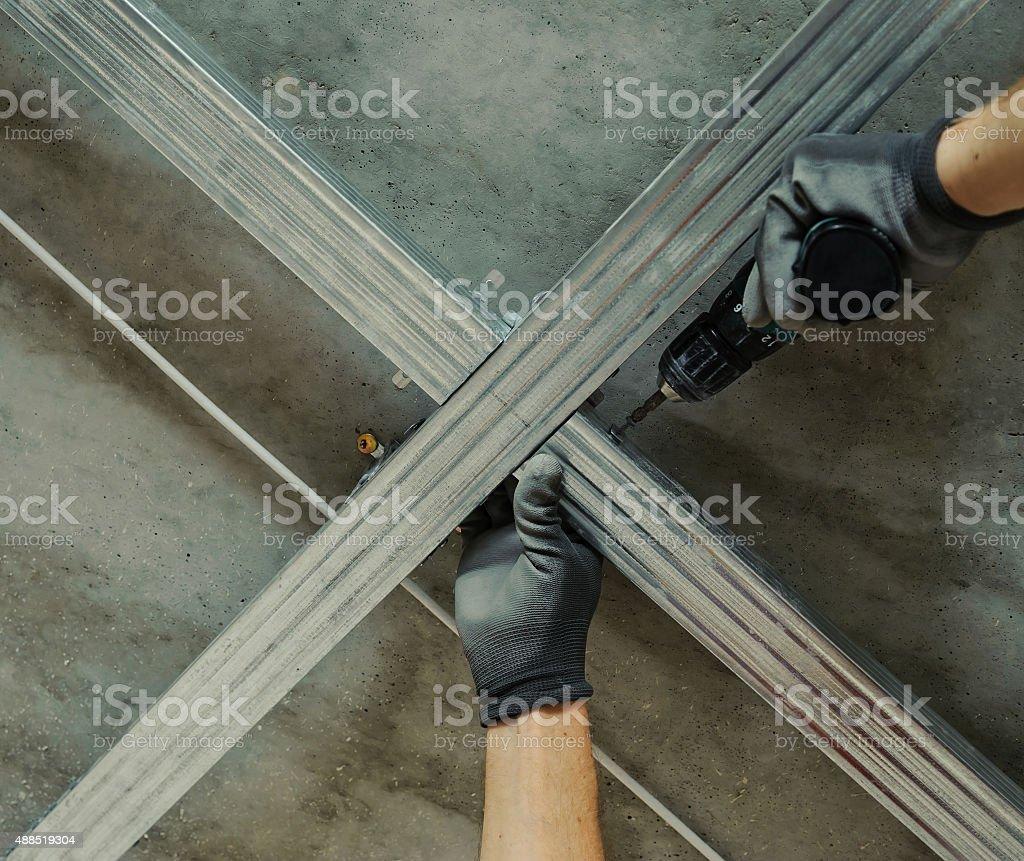 Man assembles profile metal frame stock photo