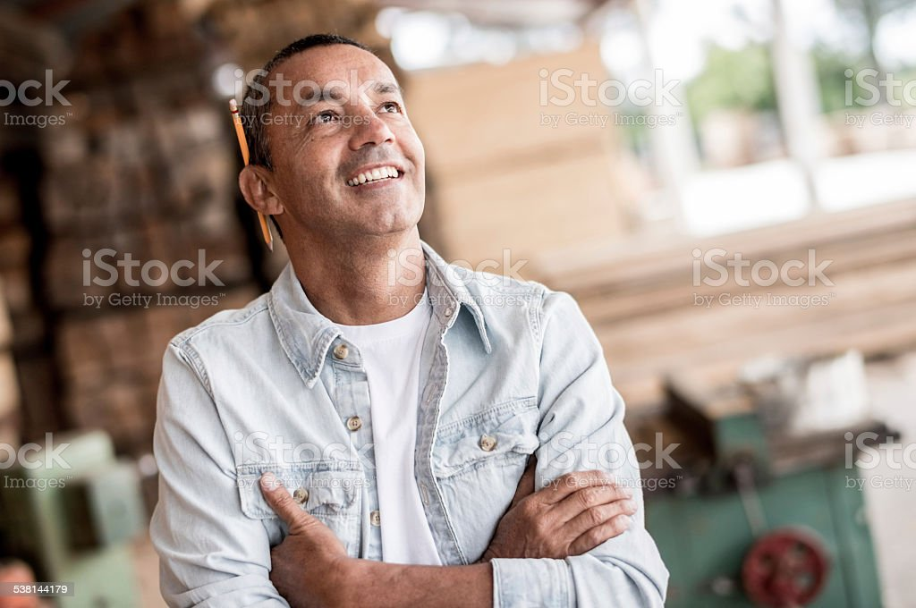 Man at a carpentry looking thoughtful stock photo