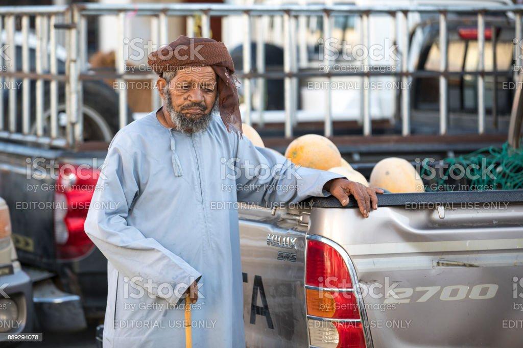 man at a market stock photo