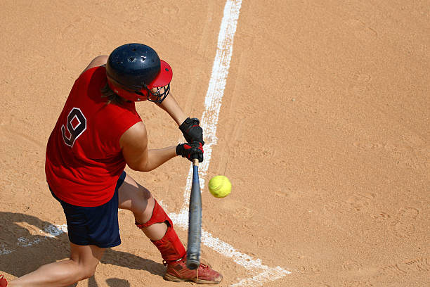 a man at a sports pitch playing softball - softball stock photos and pictures