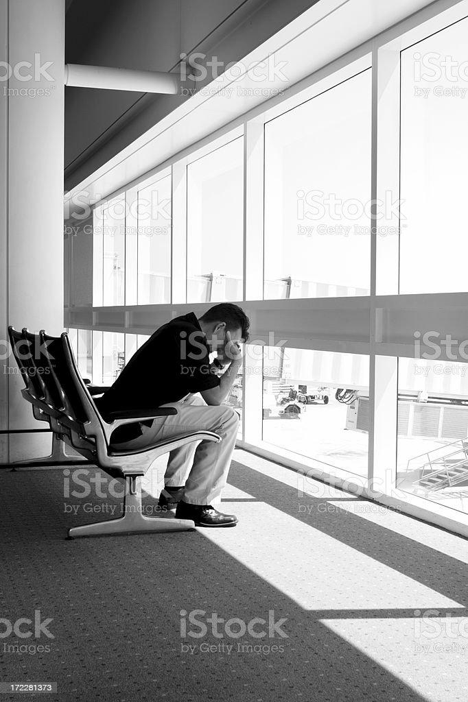 Man at airport misses flight royalty-free stock photo