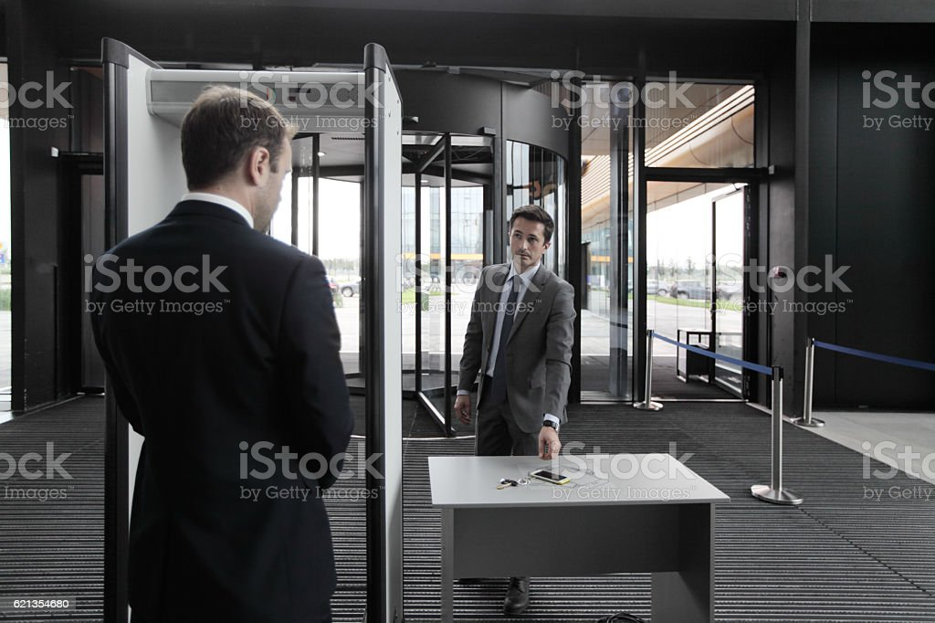 Man at airport security gates stock photo