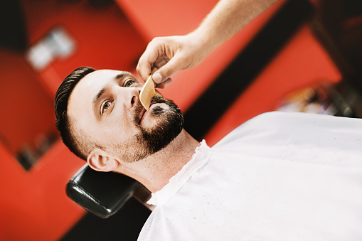 986804130 istock photo Man at barber shop. 1020522322