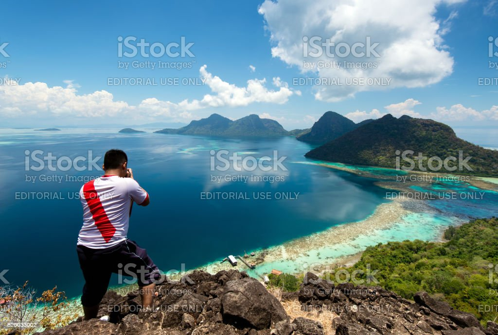 Man at Bohey Dulang Island in Sabah Borneo. stock photo
