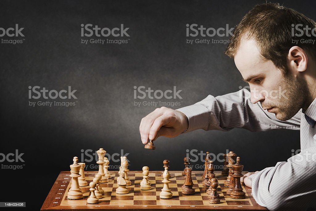 Man at chess board royalty-free stock photo